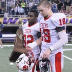 Seniors Randy Bryan and Ike Boettger leave the field with trophy in-hand after losing to Cedar Rapids Xavier.