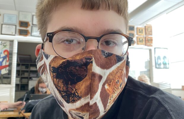 Ethan Miller models a homemade mask, which is one way to help the community during COVID.
